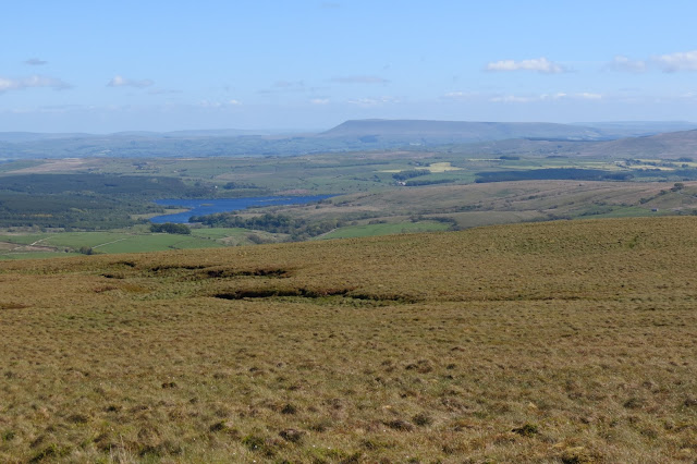 Moorland and Stocks Reservoir below with Pendle Hill on the horizon.