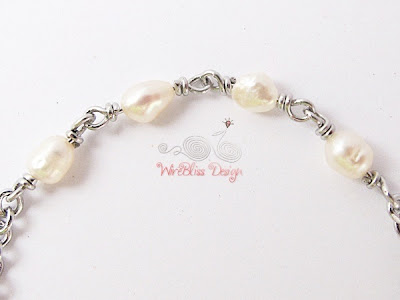 Close up of wire wrapped minima bracelet (Minlet) with pearl - Wisdom