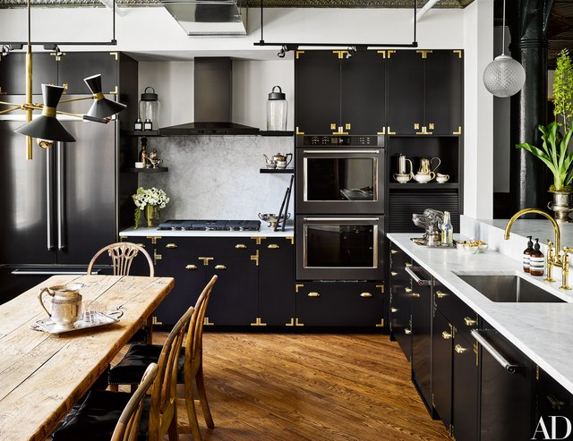 Sleek Black Cabinetry With Brass Hardware, Including The Added Touch Of  Brass Luggage Corners, Topped Their List Of Best Kitchen Design Ideas.