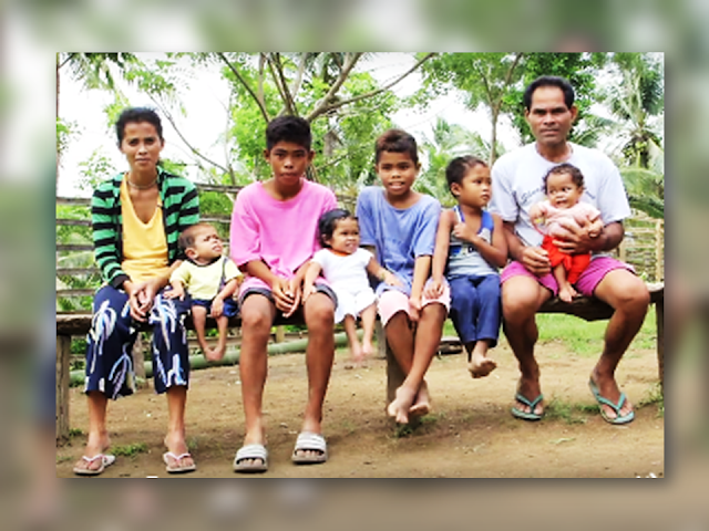 """We often hear parents saying that they wish that their kids would remain kids forever. Be careful what you wish for cause you just might have it. In Jose Dalman, Zamboanga del Norte 3 siblings with rare medical conditions has been discovered by KMJS. Only judging by the looks of them, you will not believe that 2 of them are actually on their teens.    Samuel, 2 years old, the youngest, measures only 22 inches. He is irritable and a cry baby. He just sit all the time and at his age, he cannot crawl like normal babies his age could normally do.  Maymay, 14, like a typical teenage girl, she is a shy type, timid girl but she is very generous in showing her smile to people. A teenager trapped in a toddlers body. Among the three, she is the only one who can stand up and walk by herself.  Jeto, 18 years old, is the oldest son, unlike Maymay, Jeto cannot stand and walk on its own but with the aid of something where he can hold onto, he can stand up. At his age, Jeto only measures 22 inches. Both their parents are normal and they have 3 normal siblings.  Charlie and Leonisa Atig has six children,three of them grew up normally. As the father of these children only  make P200-300 a day, they hardly have the money to provide milk for their youngest. According to Dr. Oliver Allan Dampil, an endocrinologist, their condition is called """"cretinism"""". Compared to dwarfism that has unproportionate growth on the body parts, people with cretinism, the growth of their body parts has noticeably proportionate growth. The usual cause of this condition, according to him, is the deficiency of thyroid hormones which is vital for growth and development. Aside from arrested development of their physique, people with cretinism also has slow development of their brains. In dwarfism, they can grow up to 4 feet in height, however, in cretinism, they just stop growing. According to Dr. Dampil, cretinism can be attributed to iodine deficiency during the early development. This condition based on what t"""