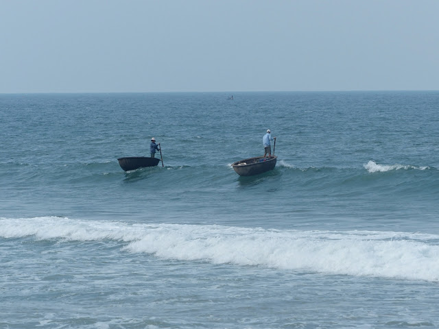 Vietnamese fishermen on their hemispheric boats, Hoi An