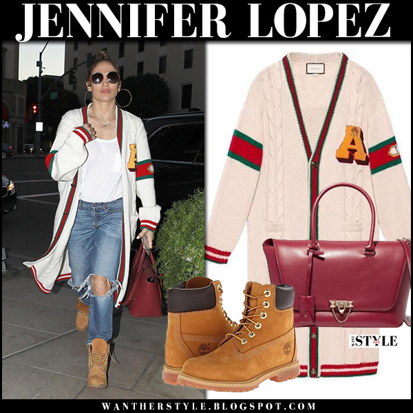 Jennifer Lopez in long white embroidered cardigan gucci, ripped jeans and brown boots timberland street style december 27