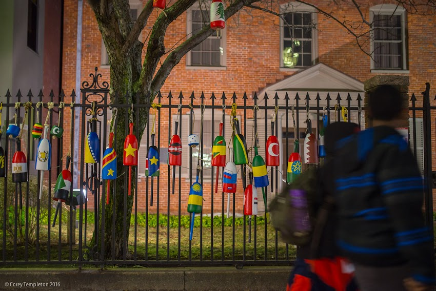 Portland, Maine USA February 2016 photo by Corey Templeton of painted flag buoys art pieces on the fence at Longfellow House Maine Historical Society.