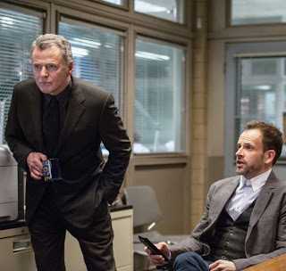 Jonny Lee Miller as Sherlock Holmes and Aidan Quinn as Captain Gregson in CBS Elementary Episode # 18 Deja Vu All Over Again