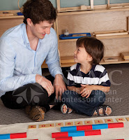 older child helping younger boy most challenging montessori student