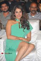 Actress Isha Koppikar Pos in Green Dress at Keshava Telugu Movie Audio Launch .COM 0004.jpg