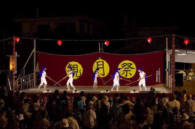 martial arts performance on stage at night