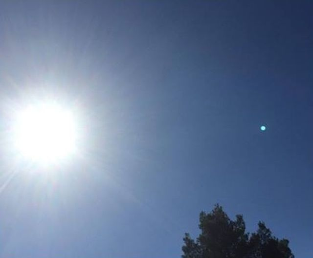 blue planet like object in the sky appears over arizona and spain