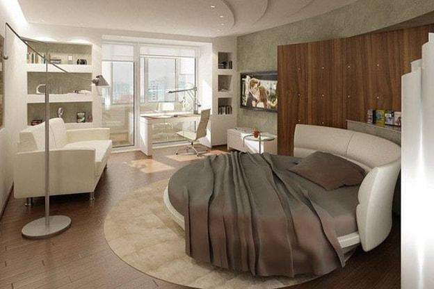 غرفة نوم بسرير مستدير