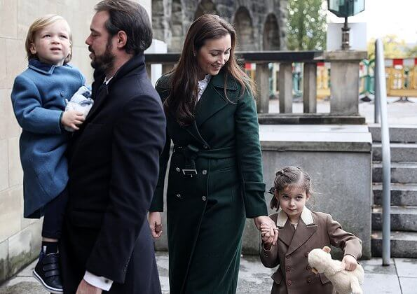 Prince Felix, Princess Claire and their children Princess Amalia and Prince Liam. Maria Teresa. Claire worn a green wool trench coat