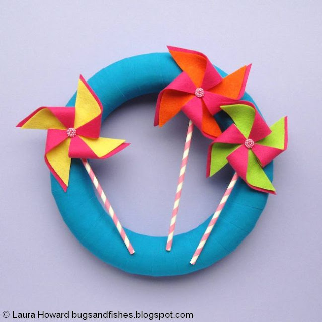 fabric-wrapped wreath decorated with handmade felt pinwheels