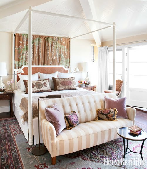 bedroom with canopy bed, a striped sofa and gorgeous accent pillows by Peter Dunham