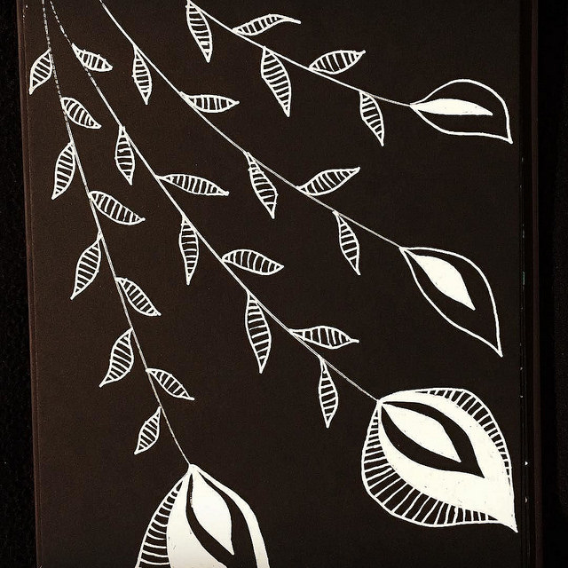Abstract flowers drawn with white ink on black paper. By Boriana Giormova