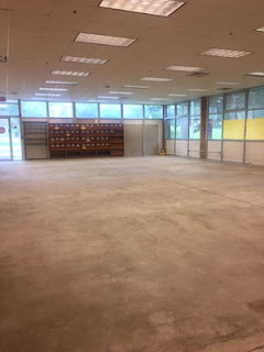 Concrete floors and wall shelving in large open area