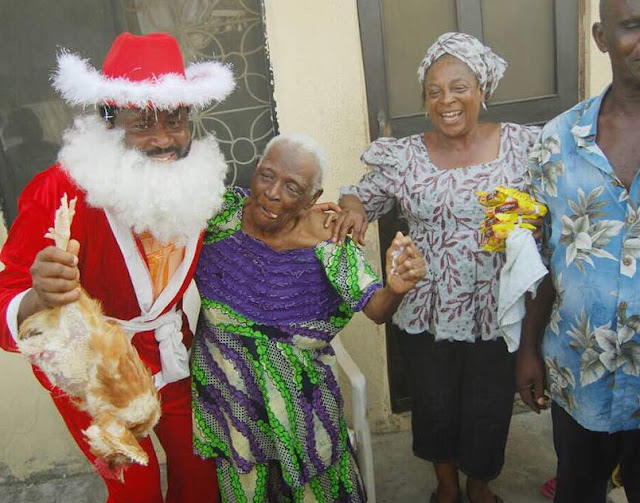 Desmond Elliot dresses up as Father Christmas ,visits his constituency