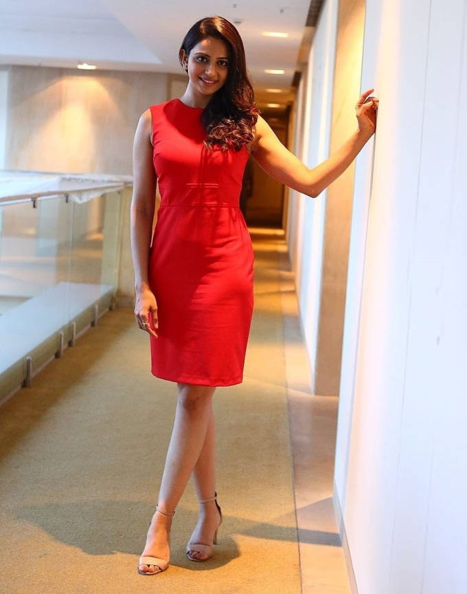 Indian Actress Rakul Preet Singh Hot Cross Legs Stills In Red Dress