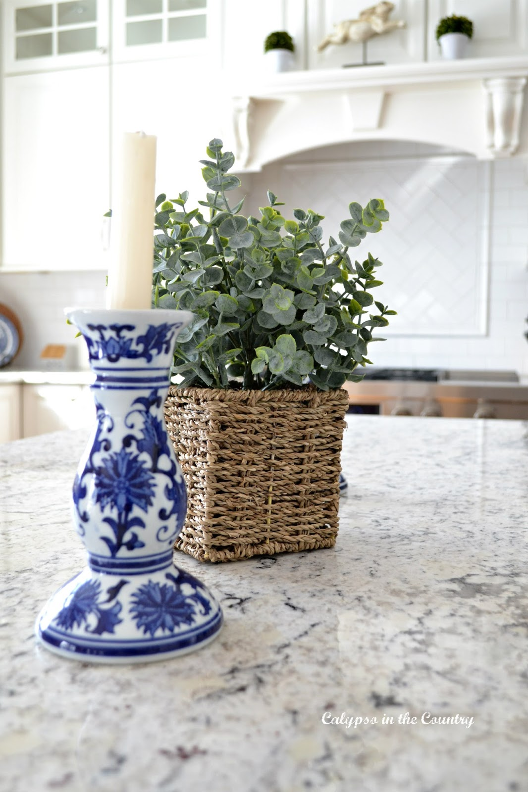 blue and white candlesticks in kitchen