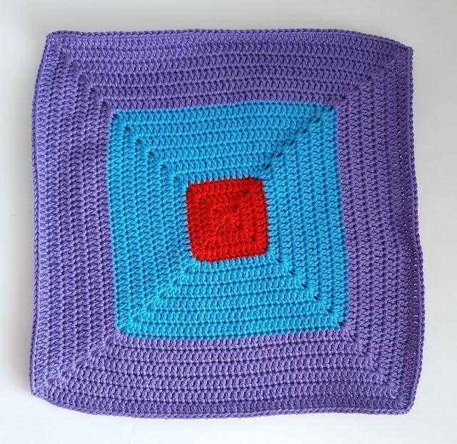 Bright colourful crochet colour-block squares.