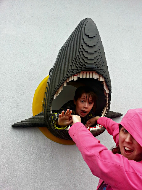 Children posing with the Lego shark at Legoland Windsor resort.