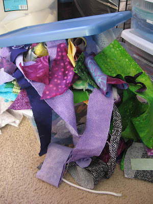 Overflowing box of fabric scraps