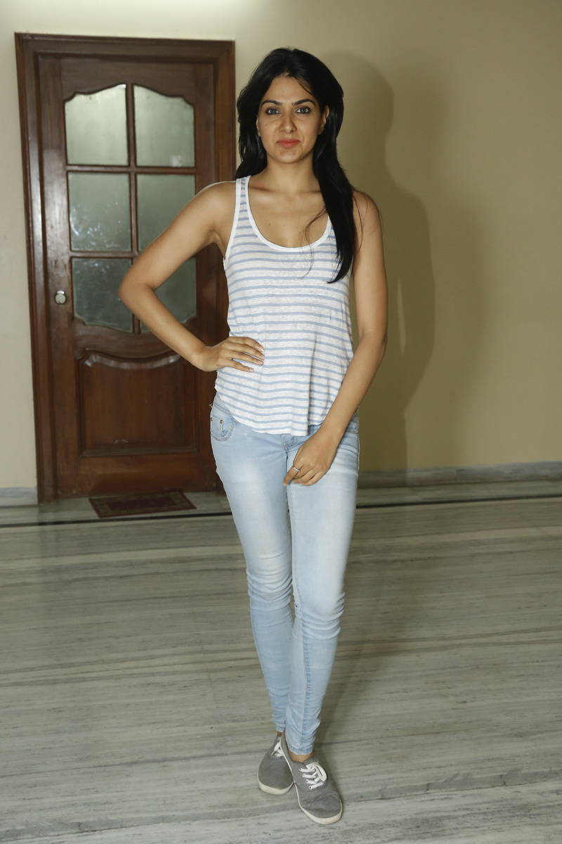 Beautiful Telugu Girl Sakshi Chaudhary Stills In White Top Jeans
