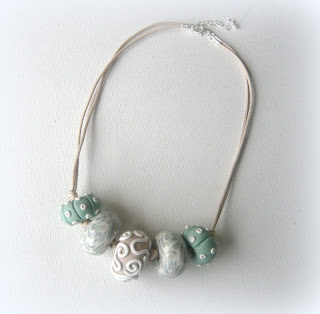 Polymer clay oblate necklace with urchin tones
