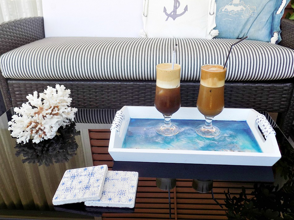 Resin beach art on a tray, cold coffee