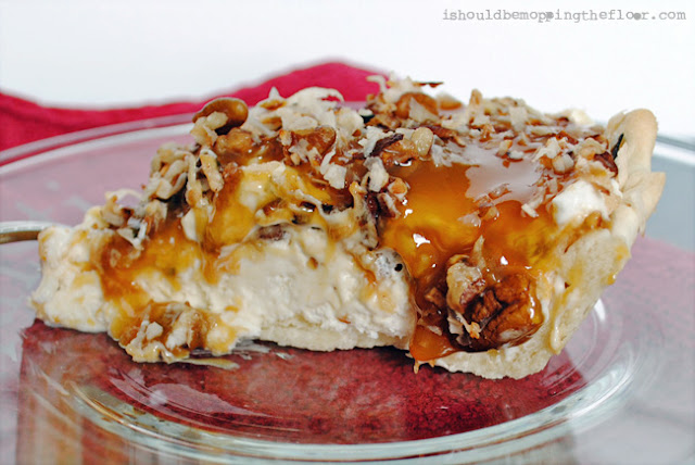 The only part of this pie that has to be baked is the crust! The rest is just layers of fabulous, including cream cheese, caramel, pecans, coconut and more! It's a show stopper that tastes amazing! Recipe makes two pies: freeze one for later!