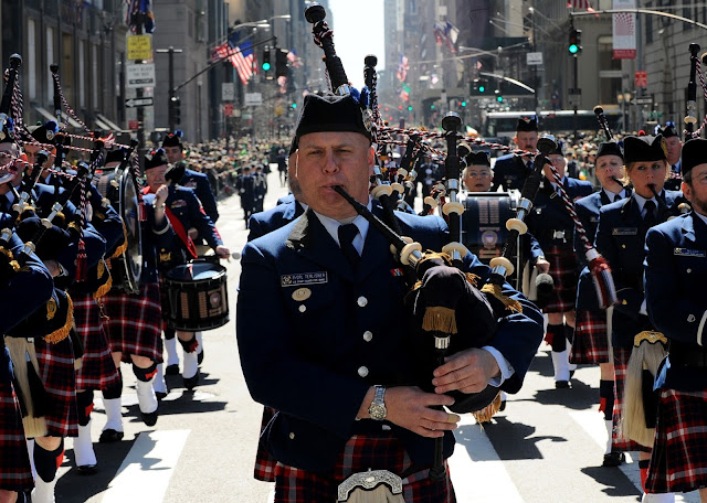 A picture of the US Coast Guard Pipe Band marching in the Saint Patrick's Day Parade in New York