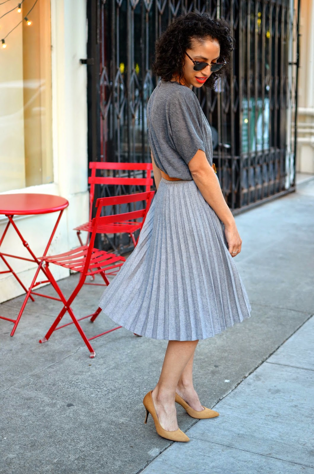 short curly hair, grey outfit, grey pleated skirt, hermes, vintage