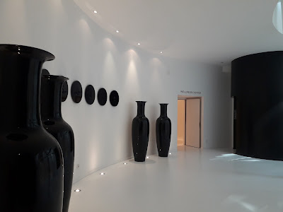 View of modern sculptures shapes as black vases at the spa entrance