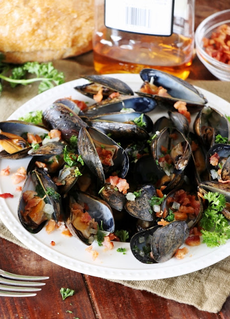 Put mussels on your menu with this quick and easy Bourbon and Bacon Steamed Mussels recipe!  Packed with flavor, this impressive dish is super simple to make ... and ready from start-to-finish in about 20 minutes flat.