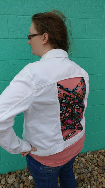 Upcycled jean jacket using fabric weaving
