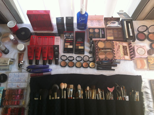 a picture of the table full of makeup that I lay out before each job so that everything is readily available