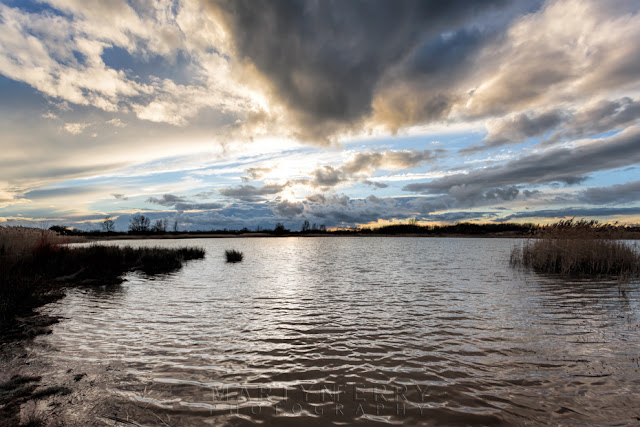 Ripples on a lake under stormy skies at Ouse Fen Nature Reserve
