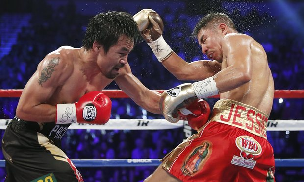 Manny Pacquiao, left, trades punches with Jessie Vargas