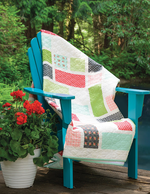 Grandstand quilt pattern found in the Fresh Fat Quarter Quilts book by Andy Knowlton of A Bright Corner - a modern, fresh way to use medium and large scale prints