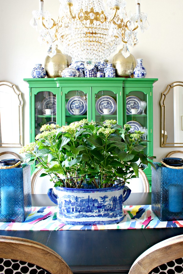 green china cabinet, blue and white pottery, blue willow, china hutch styling, vintage crystal chandelier, Lamps Plus Uttermost Petrizzi Mirror, blue glass lanterns, kate spade brush stroke table runner