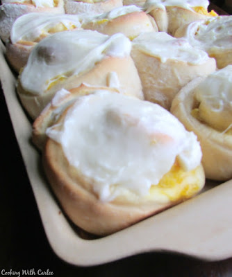 tray of pineapple breakfast rolls with vanilla frosting