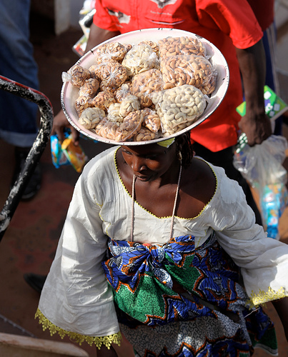 African street food vendor selling cashew nuts in Nigeria
