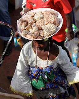 African street food vendor selling cashew nuts in Nigeria
