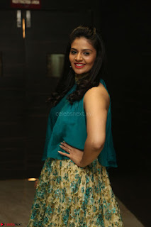 Anchor Srimukhi in green sleeveless top and skirt at O Pilla Nee Valla Movie Audio Launch Feb 2017 113.JPG