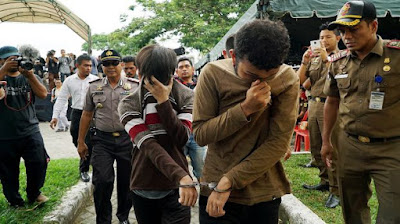 Gay men flogged, Indonesia