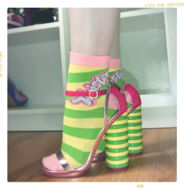 shoe blogger feet wearing ASOS Walls Twister ice lolly heeled shoes from side with matching socks