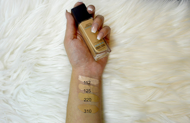 Maybelline Fit Me Matte and Poreless packaging and swatches of shades 112 Natural Ivory, 125 Nude Beige, 220 natural beige and 310 sun beige