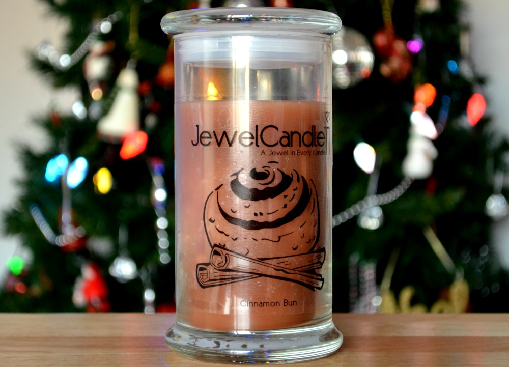 Image of the JewelCandle ring candle in front of a Christmas tree