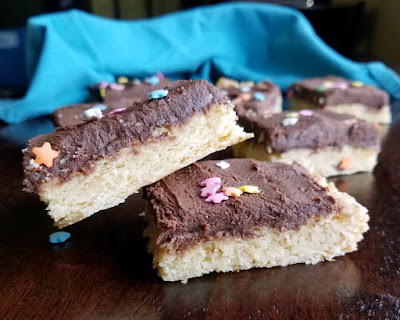 close up of chocolate frosted soft sugar cookie bars