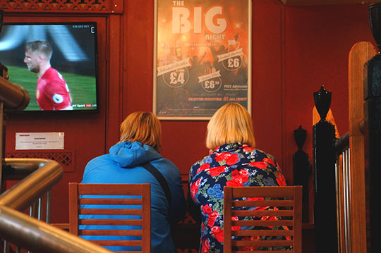 documentary photo, documentary photography, football, watching TV, pub, women in pub, pub culture, contemporary, Sam Freek,