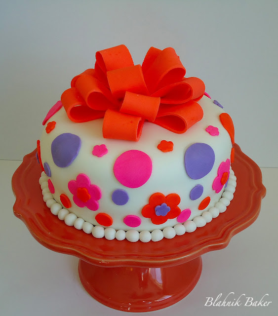 Cute fondant decorated cake - Fondant is a tasteless, thick paste, made of sugar and water. It can be colored and flavored, so it is often used for decorating cakes.