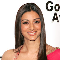 suave and bonny Tabu at award function in red dress